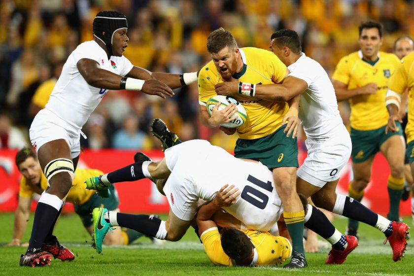 <p>BRISBANE, AUSTRALIA &#8211; JUNE 11: Greg Holmes of the Wallabies is tackled during the International Test match between the Australian Wallabies and England at Suncorp Stadium on June 11, 2016 in Brisbane, Australia.  (Photo by Cameron Spencer/Getty Images)</p>