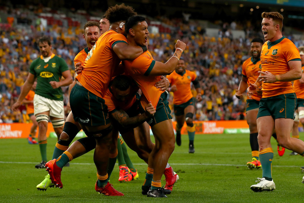 Wallabies centre Len Ikitau celebrates after a try at Suncorp Stadium against the Springboks
