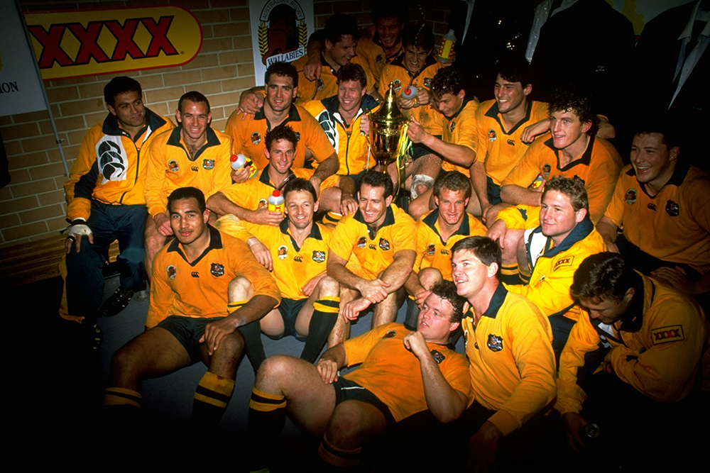 The 1991 Wallabies squad celebrate a win over England in Sydney. Photo: Getty Images