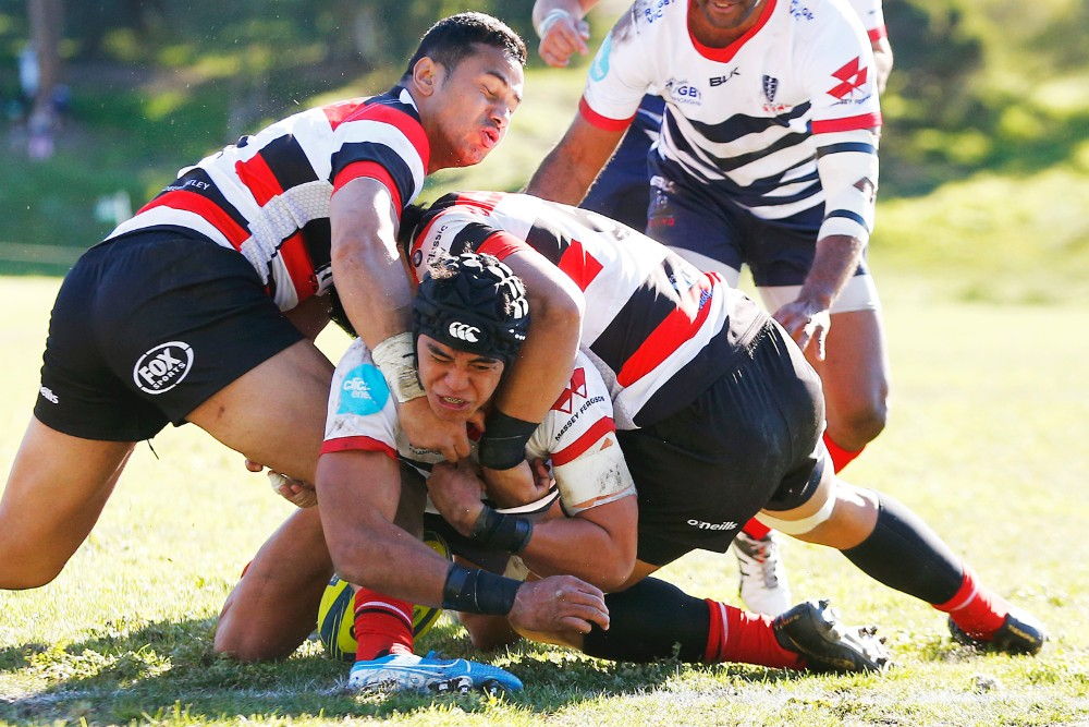 Canberra Vikings players attempt to hold up Rising centre Semisi Tupou over the line to take advantage of the law variation. Photo: Getty Images