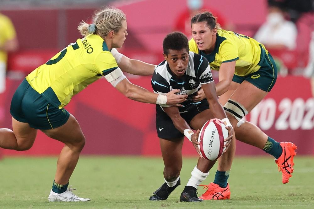 Reapi Ulunisau takes on Emma Tonegato during Fiji's Quarter Final win over Australia on day two of Tokyo2020