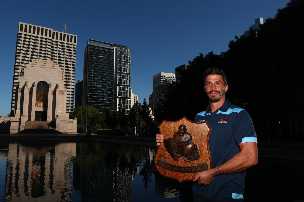 Jake Gordon poses with Weary Dunlop Shield ahead of Rebels clash. Photo: Getty Images