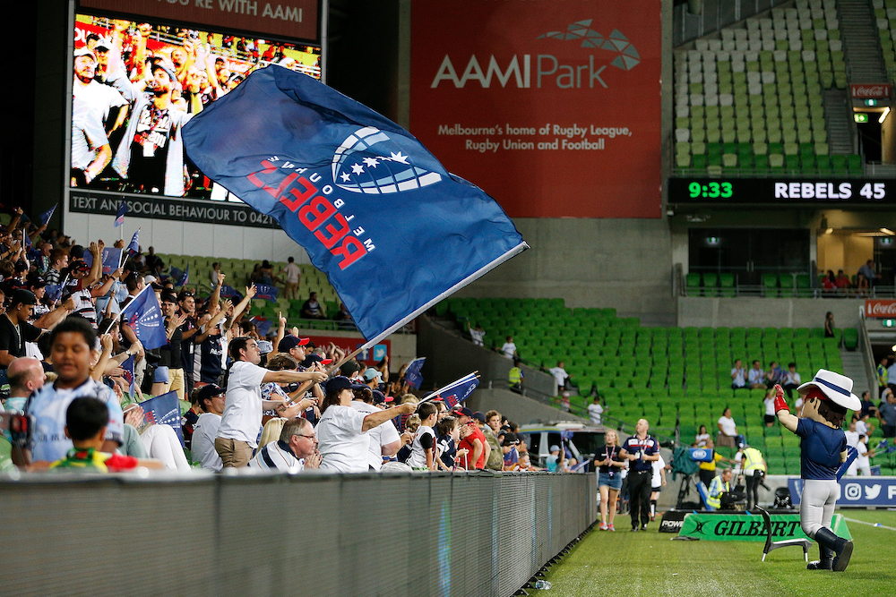 Rebels crowd with flag and mascot