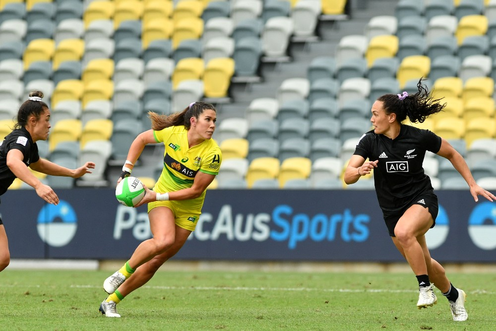 Charlotte Caslick takes on Portia Woodman during the 2021 PacificAus Sports Oceania Sevens