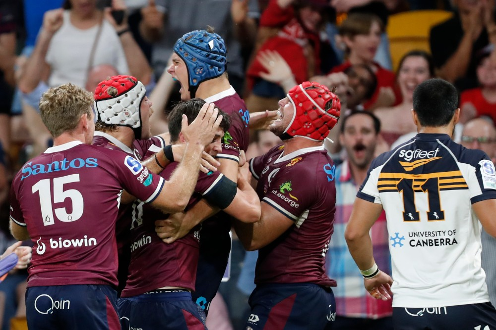Reds celebrate a Josh Flook try during their win over the Brumbies. Photo: Getty Images