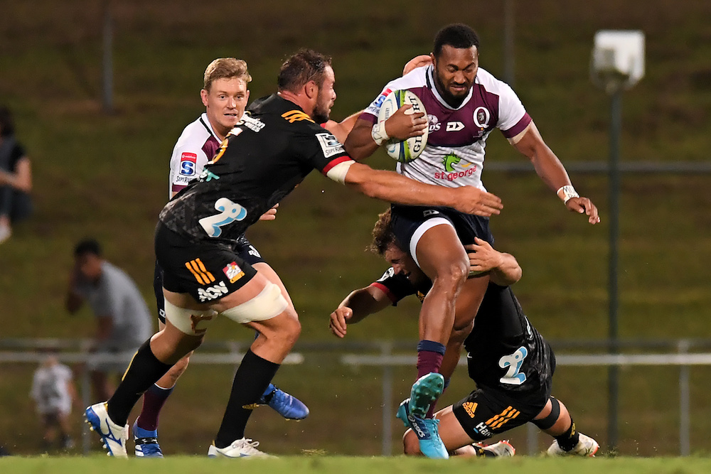 Bryce Hegarty looms in support for Sefa Naivalu in Queensland's trial against the Chiefs. Photo: Getty Images