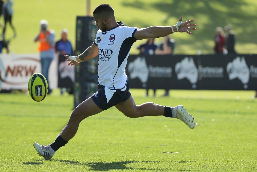 Queensland Country flyhalf Rohan Saifoloi kicks in general play. Photo: Getty Images
