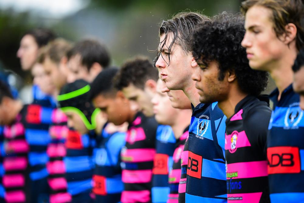 Barossa Rams and Burnside players observe a moments silence before the inaugural Kade MacDonald Shield. Photo: Rugby AU Media/Stuart Walmsley