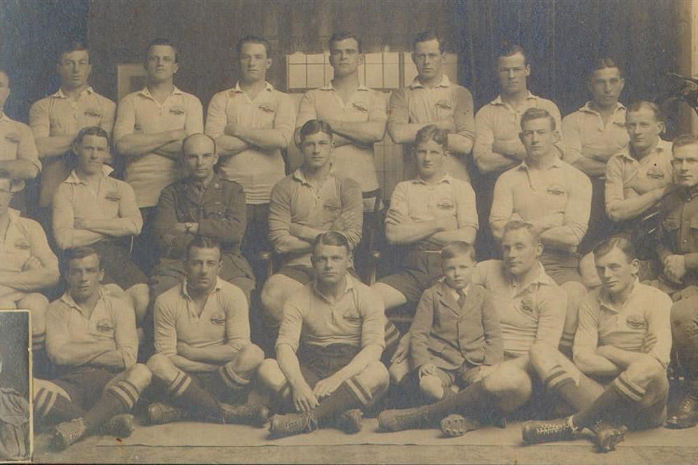 Australian AIF team in 1919, with Dan Carroll pictured in the front row with his son on his knee. Carroll paid his own fare to London to play in the Kings Cup to celebrate the WWI victory. Photo: ARU Archive.