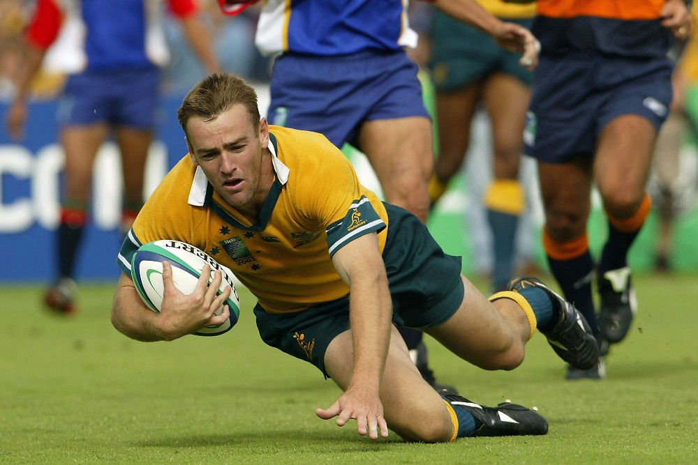 Chris Latham scoring one of five tries during their 2003 World Cup thumping of Namibia. Photo: Getty Images