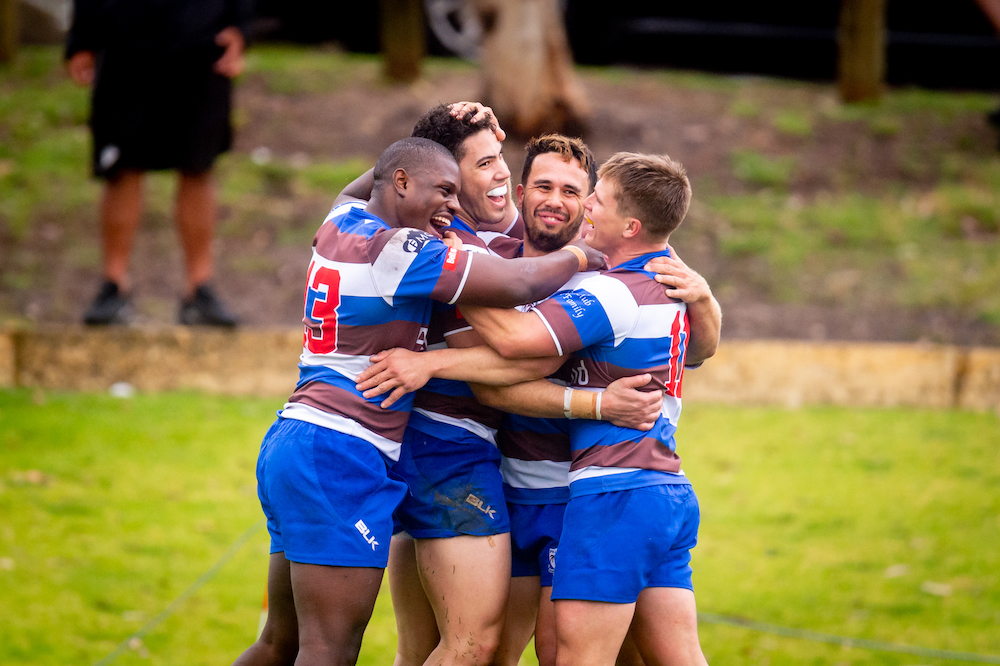 Palmyra celebrating a try in the Fortescue Premier Grade.