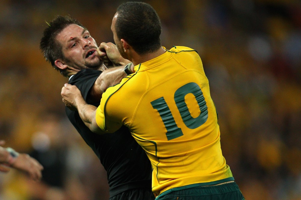 Quade Cooper takes on Richie McCaw in the 2011 World Cup, after kneeing the All Blacks captain in the head in the Bledisloe series earlier in the season. Photo: Getty Images