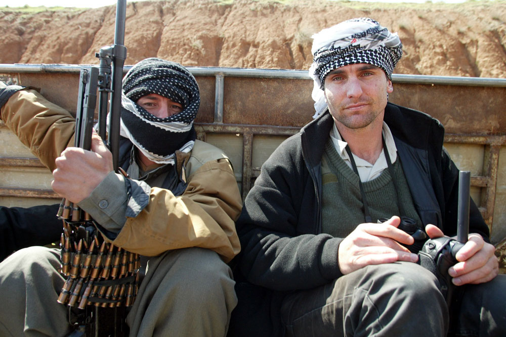 Ware (right) in the back of a sheep truck just before the 2003 U.S. invasion of Iraq. Photo: Supplied